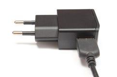 Электрическая штепсельная вилка с соединенным кабелем на белой предпосылке Стоковое Фото