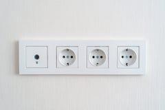 Электрические гнезда на стене Стоковая Фотография