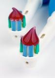 Электрические зубные щетки с зубной пастой Стоковые Изображения