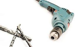 Электрический сверлильный аппарат с цыпленком и сверлами Стоковое Фото