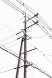 Электрический столб с белой предпосылкой () Стоковое Фото