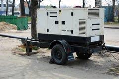 Электрический тепловозный передвижной генератор трейлера Используйте передвижной тепловозный генератор с ремонтом дороги стоковая фотография rf