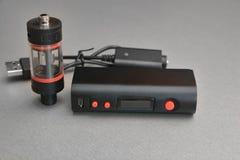 Электронные сигарета и жидкость для ее Стоковое Фото