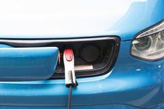 Электропитание для поручать электрического автомобиля Электрический автомобиль поручая st Стоковое Изображение RF