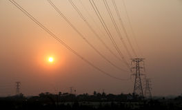 Электростанция и заход солнца Стоковое Изображение RF