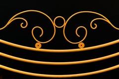 Элементы желтой загородки орнаментальные на черном backgrou Стоковая Фотография RF