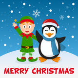 Эльф и пингвин рождества на снеге Стоковые Фото