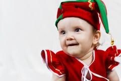 Эльф рождества ребёнка на белизне Стоковые Изображения