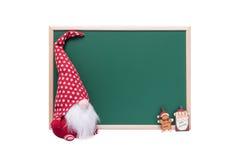 Эльф рождества, Санта Клаус и орнамент человека хлеба имбиря рядом с Стоковое Изображение RF