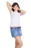 юбка джинсовой ткани брюнет Стоковые Изображения