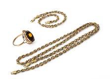 Ювелирные изделия золота на белой предпосылке Стоковые Изображения RF
