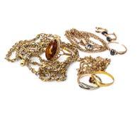 Ювелирные изделия золота на белой предпосылке Стоковое Изображение RF