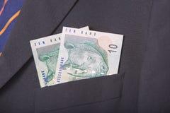 Южно-африканские ранды в карманн костюма Стоковая Фотография RF
