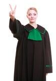 Юрист в польской мантии делая руку победы знака Стоковые Фото