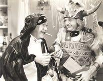 2 люд на партии костюма Стоковые Изображения RF