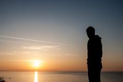 людская форма Красивый восход солнца над морем в Болгарии Стоковое Фото