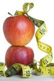 яблоки измеряют ленту Стоковая Фотография RF