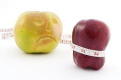 яблоки измеряют ленту 2 Стоковые Изображения