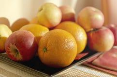 Яблоки и померанцы Стоковое Фото