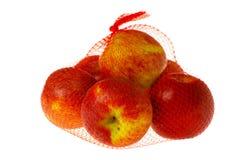 яблоки кладут изолированную сеть в мешки стоковое фото rf