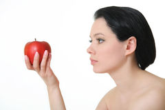 яблоко держа красную женщину стоковое изображение rf