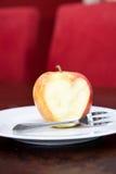 яблоко ест влюбленность к Стоковая Фотография