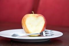 яблоко ест влюбленность к Стоковое Изображение RF