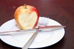 яблоко ест влюбленность к Стоковое фото RF