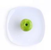 яблоко - зеленая плита Стоковое фото RF