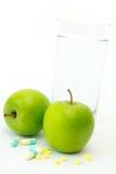 яблоко - зеленый slimming пилек Стоковая Фотография