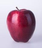 Яблоко или красное яблоко на предпосылке Стоковая Фотография