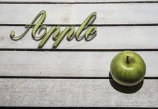 Яблоко на винтажной предпосылке Стоковое Фото