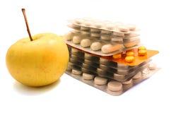 яблоко пакует желтый цвет пилек Стоковые Изображения RF