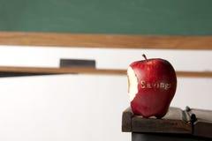 Яблоко перед классн классным Стоковая Фотография RF