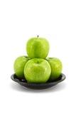 яблоко - позеленейте плиту стоковое фото rf