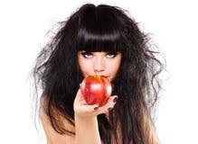 яблоко держа красную женщину Стоковая Фотография