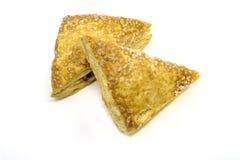 Яблочные пироги треугольника на белизне бесплатная иллюстрация