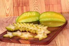 Яблоки звезды на древесине Стоковая Фотография