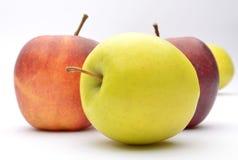 Яблоки на белой предпосылке Стоковые Изображения RF