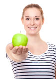 яблоко - зеленый детеныш женщины удерживания Стоковое Изображение