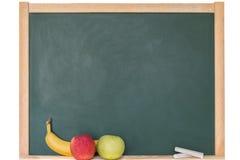 Яблоко и банан перед классн классным Стоковая Фотография RF
