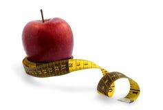 Яблоко и измеряя лента стоковые фото