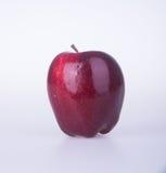 Яблоко или красное яблоко на предпосылке Стоковые Изображения