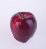 Яблоко или красное яблоко на предпосылке Стоковые Фотографии RF