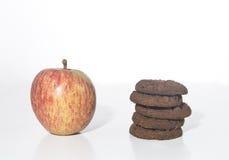 Яблоко и печенья Стоковая Фотография RF
