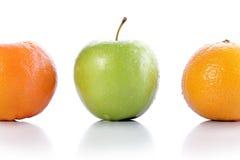 Яблоко и померанцы Стоковые Фото