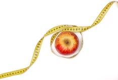 Яблоко и сантиметр Стоковое фото RF