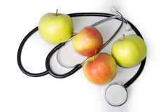 Яблоко и стетоскоп Стоковая Фотография RF