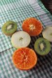 Яблоко, киви и tangerines Стоковые Фото
