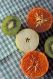 Яблоко, киви и tangerines Стоковое Фото